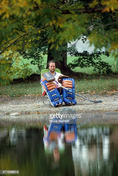 Goalie Billy Smith of the New York Islanders poses for a portrait near a lake in October 1983 in Woodbury New York