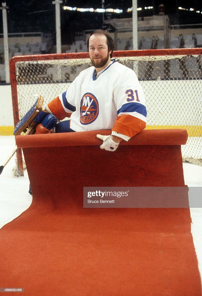 Goalie Billy Smith of the New York Islanders poses for a portrait as he rolls out the red carpet during a photo shoot in January 1983 at the Nassau...