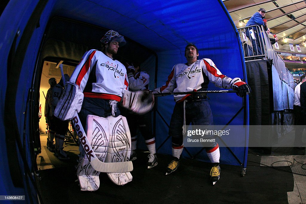 Goalie <a gi-track='captionPersonalityLinkClicked' href=/galleries/search?phrase=Braden+Holtby&family=editorial&specificpeople=5370964 ng-click='$event.stopPropagation()'>Braden Holtby</a> #70 and Alex Ovechkin #8 of the Washington Capitals look on from the tunnel prior to taking the ice to play against the New York Rangers in Game Two of the Eastern Conference Semifinals during the 2012 NHL Stanley Cup Playoffs at Madison Square Garden on April 30, 2012 in New York City.