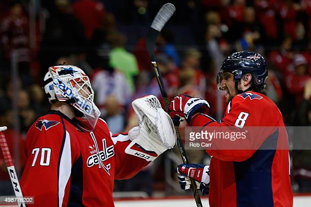 Goalie Braden Holtby and Alex Ovechkin of the Washington Capitals celebrate after the Capitals defeated the Winnipeg Jets 53 at Verizon Center on...