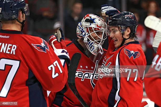 Goalie Braden Holtby of the Washington Capitals and teammate TJ Oshie celebrate after defeating the Edmonton Oilers 10 at Verizon Center on November...