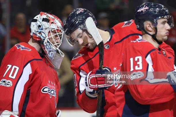 Goalie Braden Holtby of the Washington Capitals and Tom Wilson celebrate after defeating the Chicago Blackhawks at Capital One Arena on December 06...