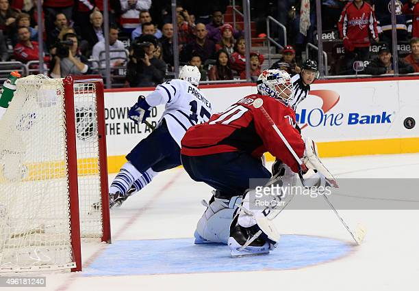 Goalie Braden Holtby of the Washington Capitals blocks a shot by PA Parenteau of the Toronto Maple Leafs during the Capitals 32 shootout win at...