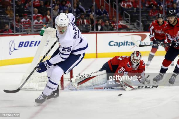 Goalie Braden Holtby of the Washington Capitals blocks a shot by James van Riemsdyk of the Toronto Maple Leafs in the first period at Capital One...