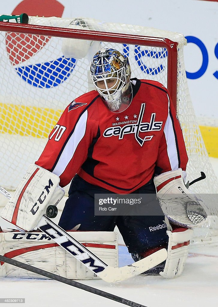 Goalie <a gi-track='captionPersonalityLinkClicked' href=/galleries/search?phrase=Braden+Holtby&family=editorial&specificpeople=5370964 ng-click='$event.stopPropagation()'>Braden Holtby</a> #70 of the Washington Capitals blocks a shot during the third period against the Ottawa Senators at Verizon Center on November 27, 2013 in Washington, DC.