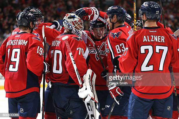 Goalie Braden Holtby of the Washington Capitals celebrates with teammates after defeating the Detroit Red Wings at Verizon Center on December 8 2015...