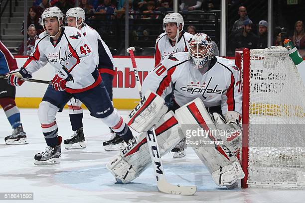 Goalie Braden Holtby of the Washington Capitals defends the goal along with Tom Wilson and Nate Schmidt of the Washington Capitals against the...