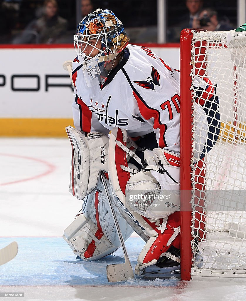 Goalie <a gi-track='captionPersonalityLinkClicked' href=/galleries/search?phrase=Braden+Holtby&family=editorial&specificpeople=5370964 ng-click='$event.stopPropagation()'>Braden Holtby</a> #70 of the Washington Capitals defends the goal against the Colorado Avalanche at Pepsi Center on November 10, 2013 in Denver, Colorado. The Avalanche defeated the Capitals 4-1.