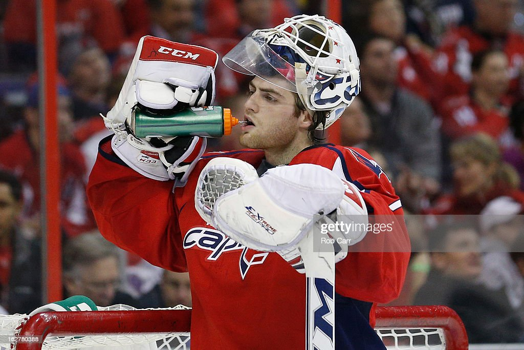 Goalie <a gi-track='captionPersonalityLinkClicked' href=/galleries/search?phrase=Braden+Holtby&family=editorial&specificpeople=5370964 ng-click='$event.stopPropagation()'>Braden Holtby</a> #70 of the Washington Capitals gets a drink during the second period against the Carolina Hurricanes at Verizon Center on February 26, 2013 in Washington, DC.