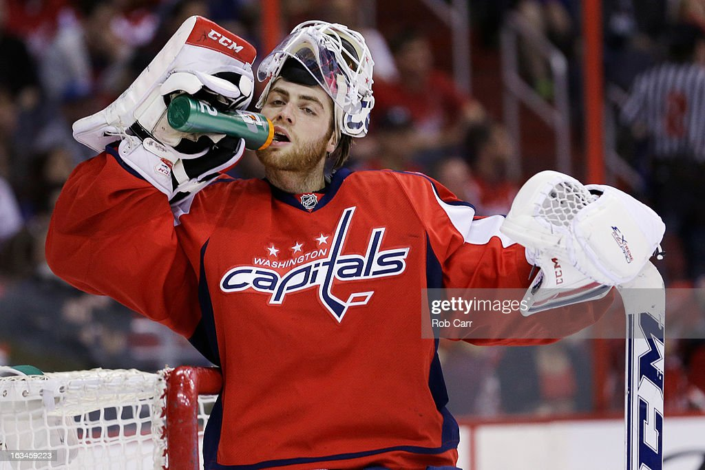 Goalie <a gi-track='captionPersonalityLinkClicked' href=/galleries/search?phrase=Braden+Holtby&family=editorial&specificpeople=5370964 ng-click='$event.stopPropagation()'>Braden Holtby</a> #70 of the Washington Capitals gets a drink during the first period against the New York Rangers at Verizon Center on March 10, 2013 in Washington, DC.