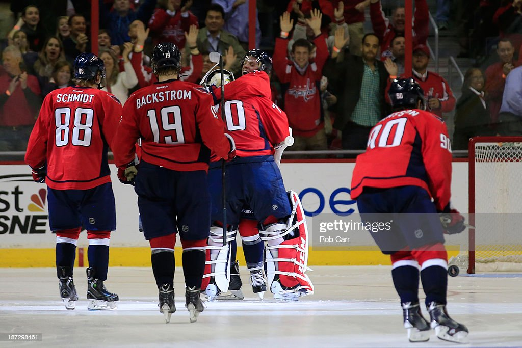 Goalie <a gi-track='captionPersonalityLinkClicked' href=/galleries/search?phrase=Braden+Holtby&family=editorial&specificpeople=5370964 ng-click='$event.stopPropagation()'>Braden Holtby</a> #70 of the Washington Capitals is congratulated after the Capitals defeated the Minnesota Wild 3-2 in a shootout at Verizon Center on November 7, 2013 in Washington, DC.