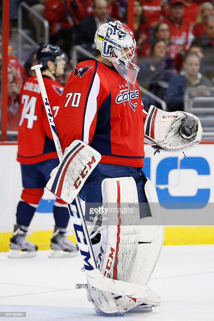 Goalie <a gi-track='captionPersonalityLinkClicked' href=/galleries/search?phrase=Braden+Holtby&family=editorial&specificpeople=5370964 ng-click='$event.stopPropagation()'>Braden Holtby</a> #70 of the Washington Capitals looks at the puck after making a second period save against the Carolina Hurricanes at Verizon Center on February 26, 2013 in Washington, DC.