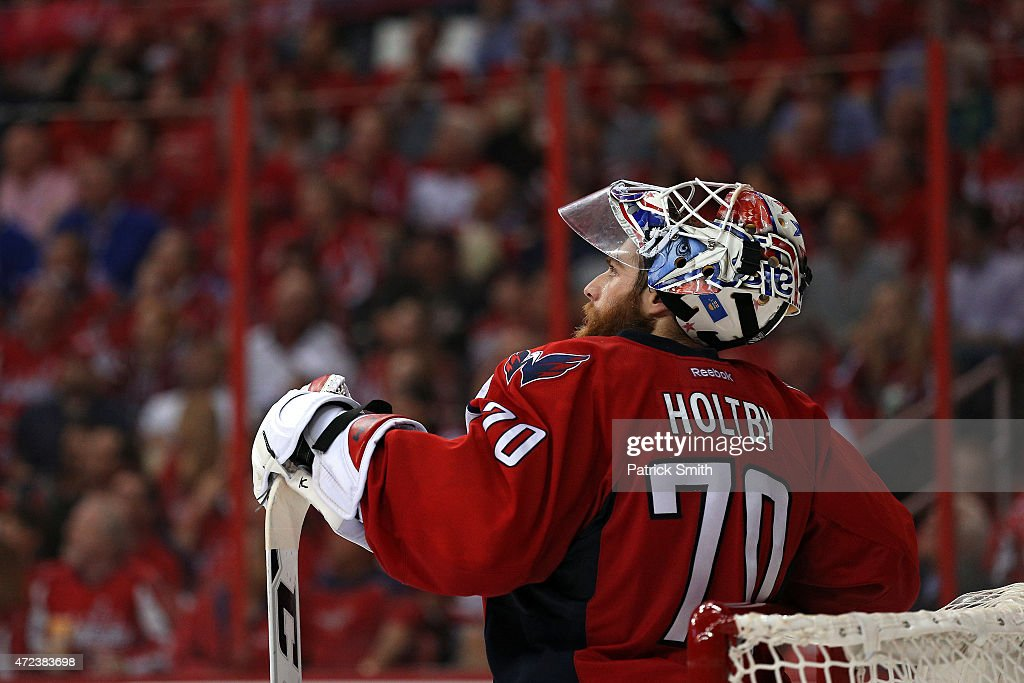 Goalie Braden Holtby of the Washington Capitals looks on after allowing a goal by Derick Brassard of the New York Rangers during the second period in...