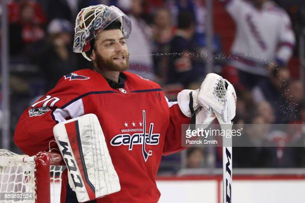 Goalie Braden Holtby of the Washington Capitals looks on after allowing a goal against the New York Rangers during the third period at Capital One...
