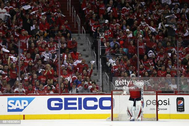Goalie Braden Holtby of the Washington Capitals looks on after giving up a third period goal against the Pittsburgh Penguins in Game Seven of the...