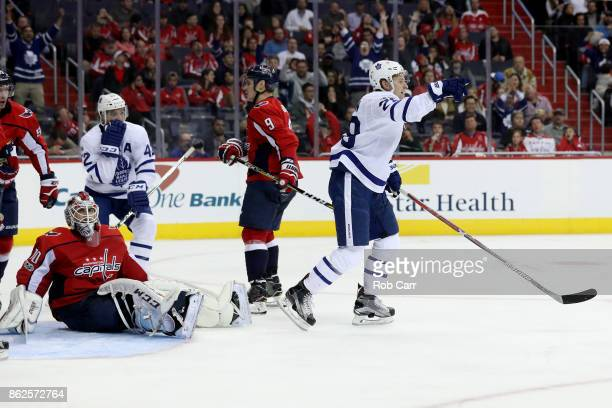 Goalie Braden Holtby of the Washington Capitals looks on as Connor Brown of the Toronto Maple Leafs celebrates scoring a third period goal at Capital...
