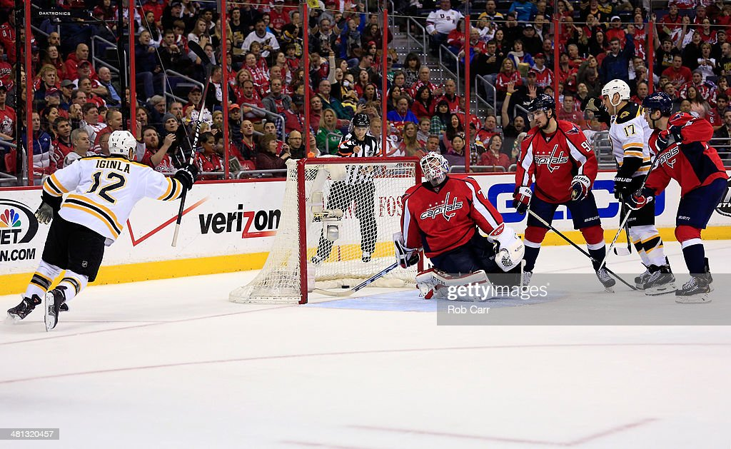 Goalie <a gi-track='captionPersonalityLinkClicked' href=/galleries/search?phrase=Braden+Holtby&family=editorial&specificpeople=5370964 ng-click='$event.stopPropagation()'>Braden Holtby</a> #70 of the Washington Capitals looks on as <a gi-track='captionPersonalityLinkClicked' href=/galleries/search?phrase=Jarome+Iginla&family=editorial&specificpeople=201792 ng-click='$event.stopPropagation()'>Jarome Iginla</a> #12 of the Boston Bruins celebrates his second period goal during the Bruins 4-2 win at Verizon Center on March 29, 2014 in Washington, DC.