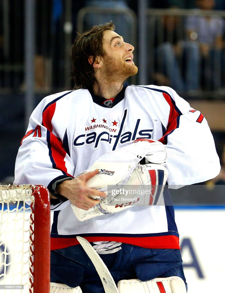 Goalie <a gi-track='captionPersonalityLinkClicked' href=/galleries/search?phrase=Braden+Holtby&family=editorial&specificpeople=5370964 ng-click='$event.stopPropagation()'>Braden Holtby</a> #70 of the Washington Capitals looks up to the scoreboard watching the replay of the goal that was just scored against him by Derick Brassard #16 of the New York Rangers during the second period in Game Six of the Eastern Conference Quarterfinals during the 2013 NHL Stanley Cup Playoffs at Madison Square Garden on May 12, 2013 in New York City. Rangers won 1-0.
