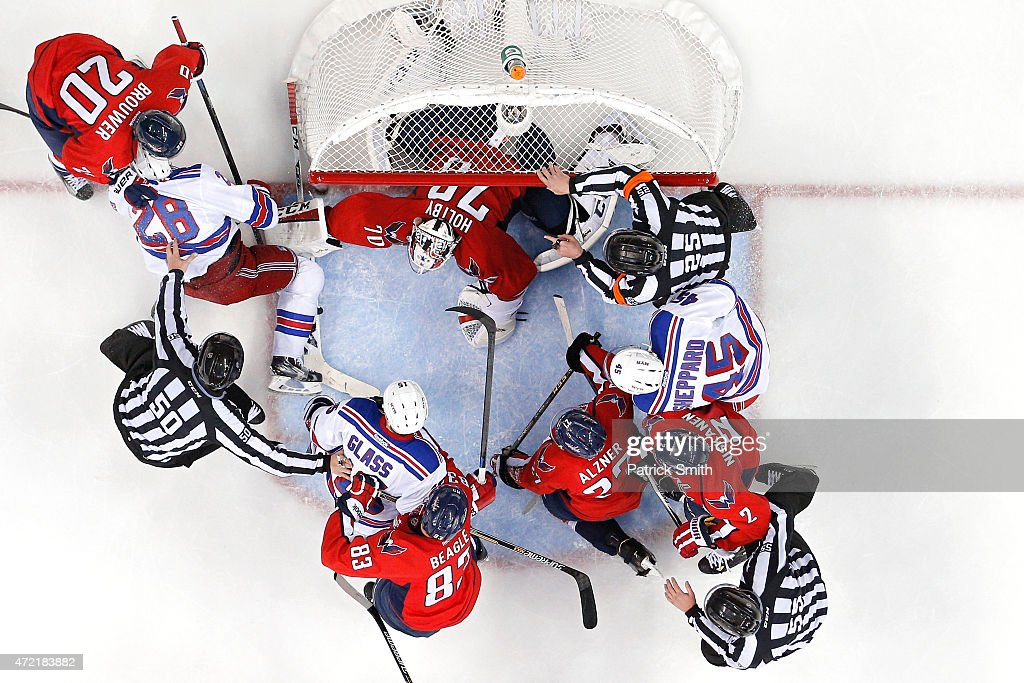 Goalie <a gi-track='captionPersonalityLinkClicked' href=/galleries/search?phrase=Braden+Holtby&family=editorial&specificpeople=5370964 ng-click='$event.stopPropagation()'>Braden Holtby</a> #70 of the Washington Capitals makes a save against the New York Rangers as players scuffle in the during the second period in Game Three of the Eastern Conference Semifinals during the 2015 NHL Stanley Cup Playoffs at Verizon Center on May 4, 2015 in Washington, DC. The Washington Capitals won, 1-0.