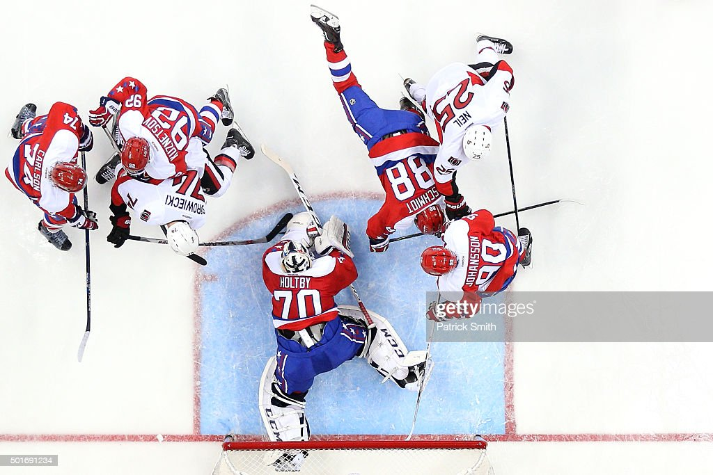 Goalie <a gi-track='captionPersonalityLinkClicked' href=/galleries/search?phrase=Braden+Holtby&family=editorial&specificpeople=5370964 ng-click='$event.stopPropagation()'>Braden Holtby</a> #70 of the Washington Capitals makes a save in the second period on <a gi-track='captionPersonalityLinkClicked' href=/galleries/search?phrase=Mark+Borowiecki&family=editorial&specificpeople=5409020 ng-click='$event.stopPropagation()'>Mark Borowiecki</a> #74 of the Ottawa Senators at Verizon Center on December 16, 2015 in Washington, DC.