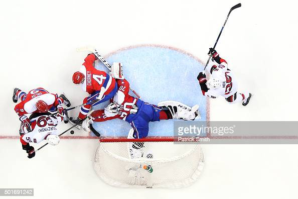 Goalie Braden Holtby of the Washington Capitals makes a save in the second period on David Dziurzynski of the Ottawa Senators at Verizon Center on...