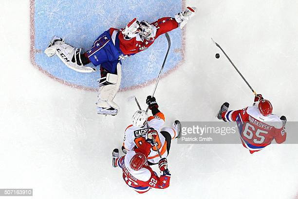 Goalie Braden Holtby of the Washington Capitals makes a save on Sam Gagner of the Philadelphia Flyers in the second period at Verizon Center on...