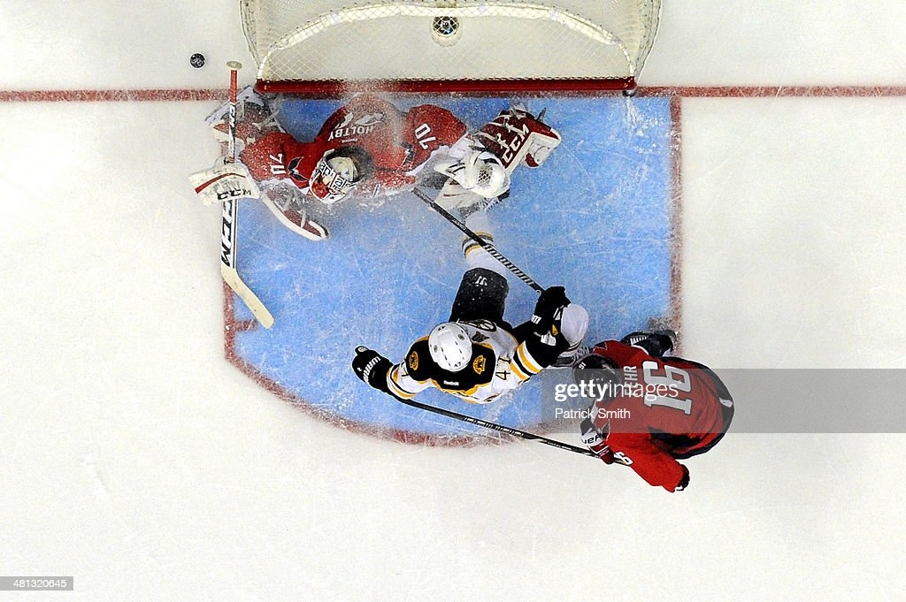 Goalie <a gi-track='captionPersonalityLinkClicked' href=/galleries/search?phrase=Braden+Holtby&family=editorial&specificpeople=5370964 ng-click='$event.stopPropagation()'>Braden Holtby</a> #70 of the Washington Capitals makes a save on <a gi-track='captionPersonalityLinkClicked' href=/galleries/search?phrase=Torey+Krug&family=editorial&specificpeople=6670036 ng-click='$event.stopPropagation()'>Torey Krug</a> #47 of the Boston Bruins as <a gi-track='captionPersonalityLinkClicked' href=/galleries/search?phrase=Eric+Fehr&family=editorial&specificpeople=566939 ng-click='$event.stopPropagation()'>Eric Fehr</a> #16 of the Capitals defends in the second period during an NHL game at Verizon Center on March 29, 2014 in Washington, DC. The Boston Bruins won, 4-2.