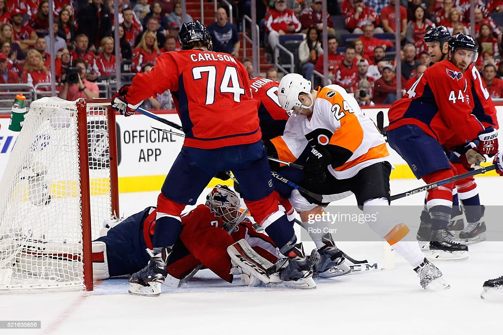 Goalie Braden Holtby of the Washington Capitals makes a stop on a shot by Matt Read of the Philadelphia Flyers in the first period of Game Two of the...