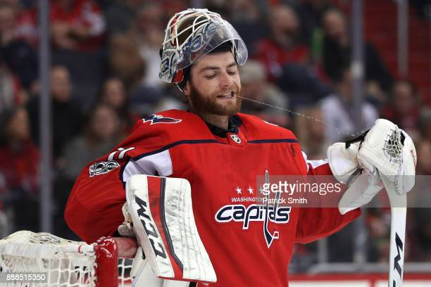Goalie Braden Holtby of the Washington Capitals reacts after allowing a goal to Lance Bouma of the Chicago Blackhawks during the first period at...