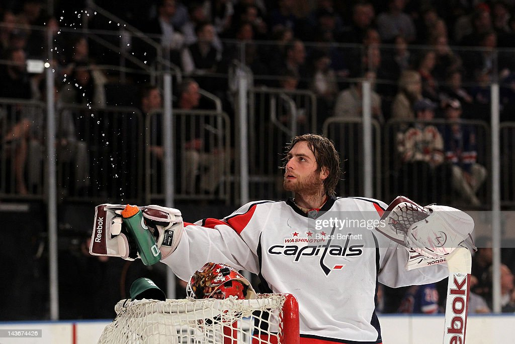Goalie <a gi-track='captionPersonalityLinkClicked' href=/galleries/search?phrase=Braden+Holtby&family=editorial&specificpeople=5370964 ng-click='$event.stopPropagation()'>Braden Holtby</a> #70 of the Washington Capitals squirts water into the air in the second period against the New York Rangers in Game Two of the Eastern Conference Semifinals during the 2012 NHL Stanley Cup Playoffs at Madison Square Garden on April 30, 2012 in New York City.