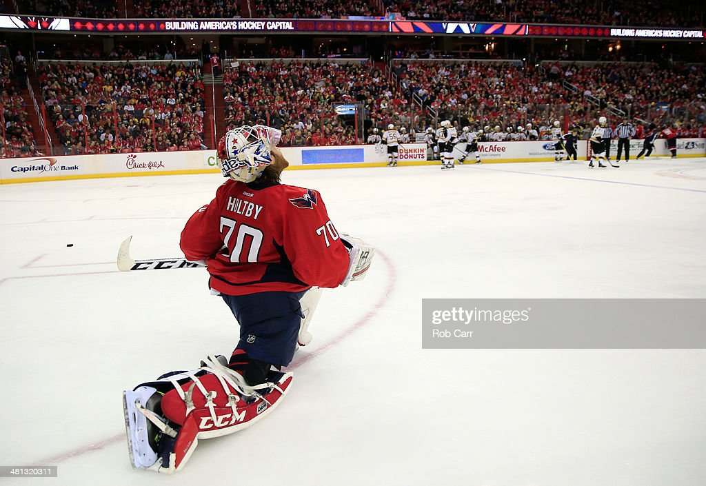 Goalie <a gi-track='captionPersonalityLinkClicked' href=/galleries/search?phrase=Braden+Holtby&family=editorial&specificpeople=5370964 ng-click='$event.stopPropagation()'>Braden Holtby</a> #70 of the Washington Capitals stretches on the ice during the second period of the Capitals 4-2 loss to the Boston Bruins at Verizon Center on March 29, 2014 in Washington, DC.