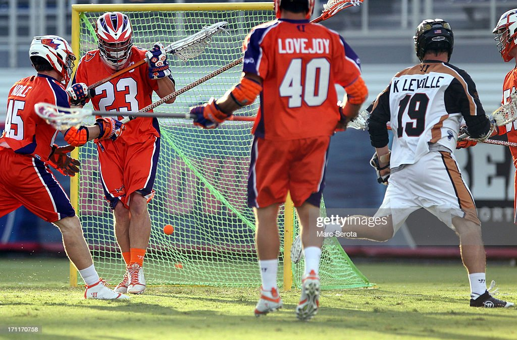 Goalie Brett Queener #23 of the Hamilton Nationals blocks a shot by Kevin Leveille #19 of the Rochester Rattlers at FAU Stadium on June 22, 2013 in Boca Raton, Florida. The Nationals defeated the Rattlers 17-11.