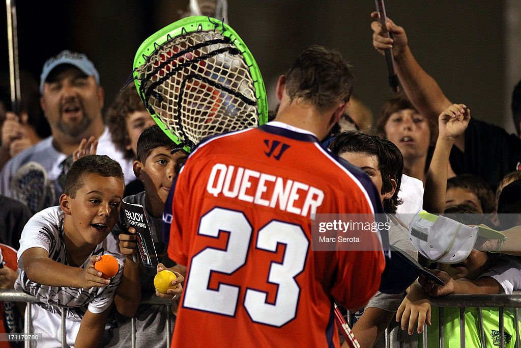 Goalie Brett Queener #23 of the Hamilton Nationals signs autographs after playing against the Rochester Rattlers at FAU Stadium on June 22, 2013 in Boca Raton, Florida. The Nationals defeated the Rattlers 17-11.