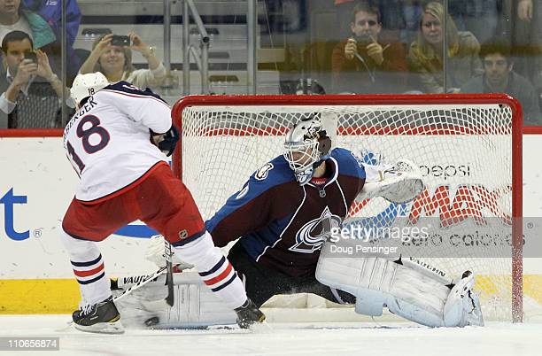 Goalie Brian Elliott of the Colorado Avalanche makes a save on a shot by RJ Umberger of the Columbus Blue Jackets during their overtime shootout at...