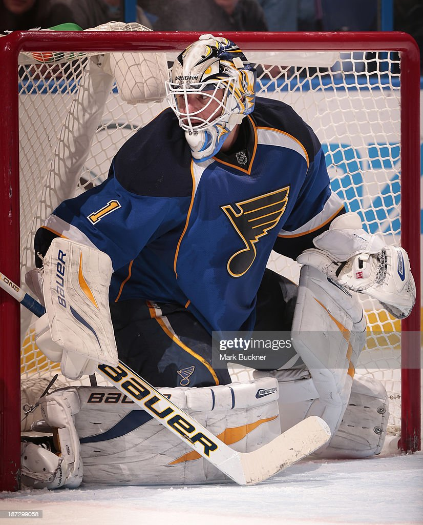 Goalie <a gi-track='captionPersonalityLinkClicked' href=/galleries/search?phrase=Brian+Elliott&family=editorial&specificpeople=687032 ng-click='$event.stopPropagation()'>Brian Elliott</a> #1 of the St. Louis Blues defends against the Calgary Flames on November 7, 2013 at Scottrade Center in St. Louis, Missouri.