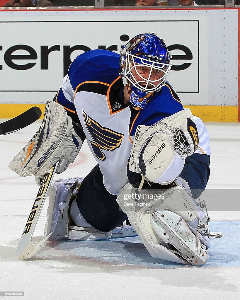 Goalie <a gi-track='captionPersonalityLinkClicked' href=/galleries/search?phrase=Brian+Elliott&family=editorial&specificpeople=687032 ng-click='$event.stopPropagation()'>Brian Elliott</a> #1 of the St. Louis Blues makes a glove save during a NHL game against the Detroit Red Wings at Joe Louis Arena on April 7, 2013 in Detroit, Michigan.