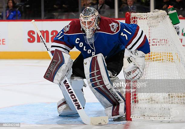 Goalie Calvin Pickard of the Colorado Avalanche defends the goal against the Winnipeg Jets at Pepsi Center on December 11 2014 in Denver Colorado The...
