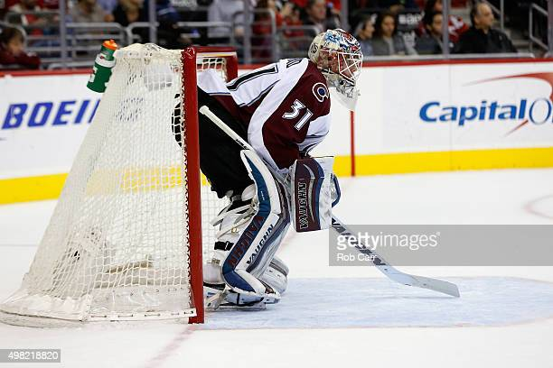 Goalie Calvin Pickard of the Colorado Avalanche follows play in the second period against the Washington Capitals at Verizon Center on November 21...