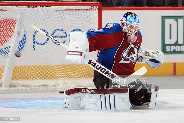 Goalie Calvin Pickard of the Colorado Avalanche warms up prior to facing the Los Angeles Kings during their preseason game at the Pepsi Center on...