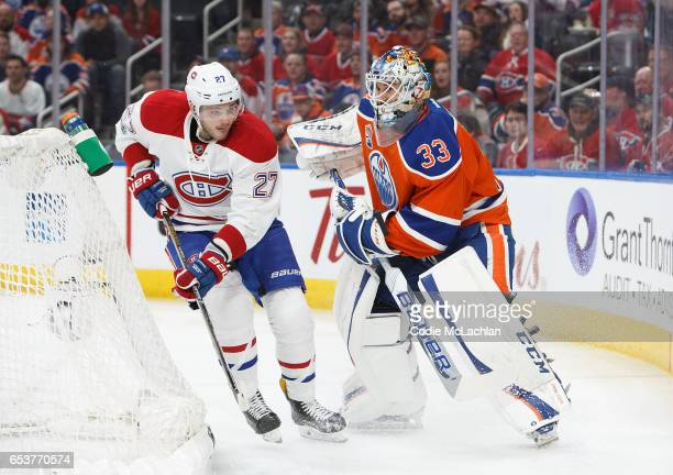 Goalie Cam Talbot of the Edmonton Oilers avoids Alex Galchenyuk of the Montreal Canadiens on March 12 2017 at Rogers Place in Edmonton Alberta Canada