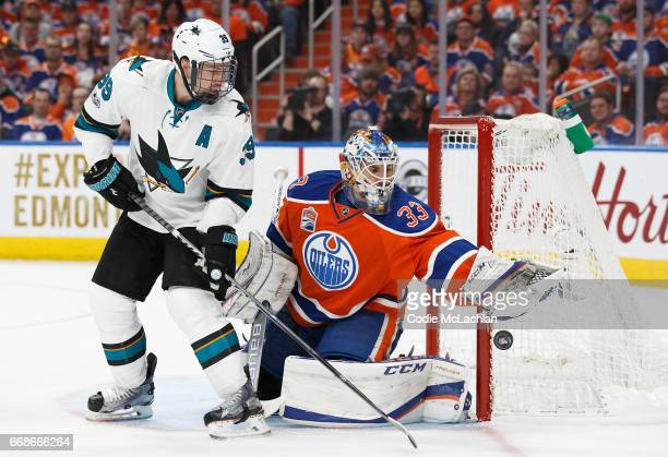 Goalie Cam Talbot of the Edmonton Oilers makes a save against Logan Couture of the San Jose Sharks in Game Two of the Western Conference First Round...