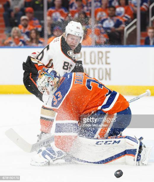 Goalie Cam Talbot of the Edmonton Oilers makes a save against Ondrej Kase of the Anaheim Ducks in Game Four of the Western Conference Second Round...