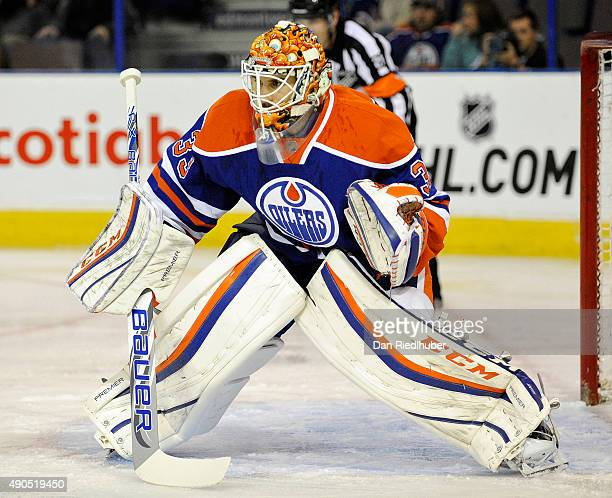 Goalie Cam Talbot of the Edmonton Oilers sets for a shot against the Calgary Flames at Rexall Place on September 21 2015 in Edmonton Alberta Canada