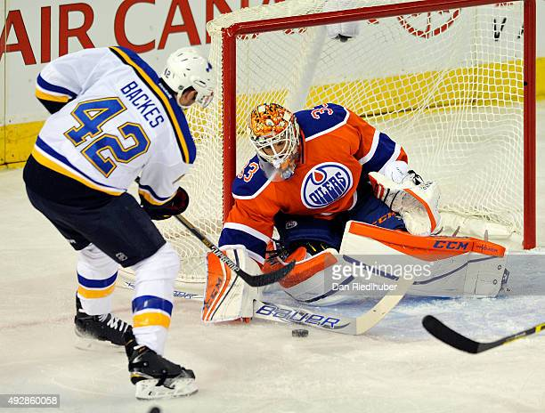 Goalie Cam Talbot of the Edmonton Oilers stops David Backes of the St Louis Blues at Rexall Place on October 15 2015 in Edmonton Alberta Canada