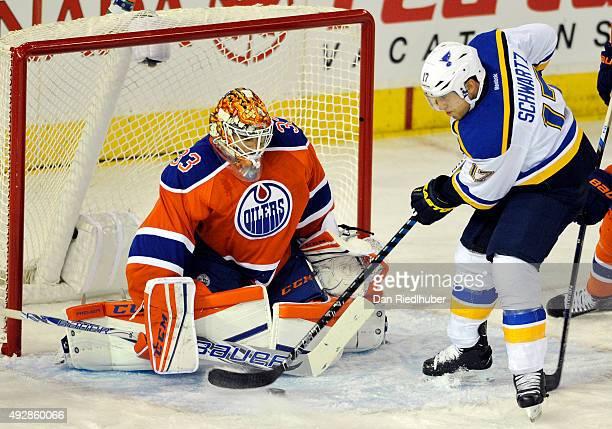 Goalie Cam Talbot of the Edmonton Oilers stops Jaden Schwartz of the St Louis Blues at Rexall Place on October 15 2015 in Edmonton Alberta Canada