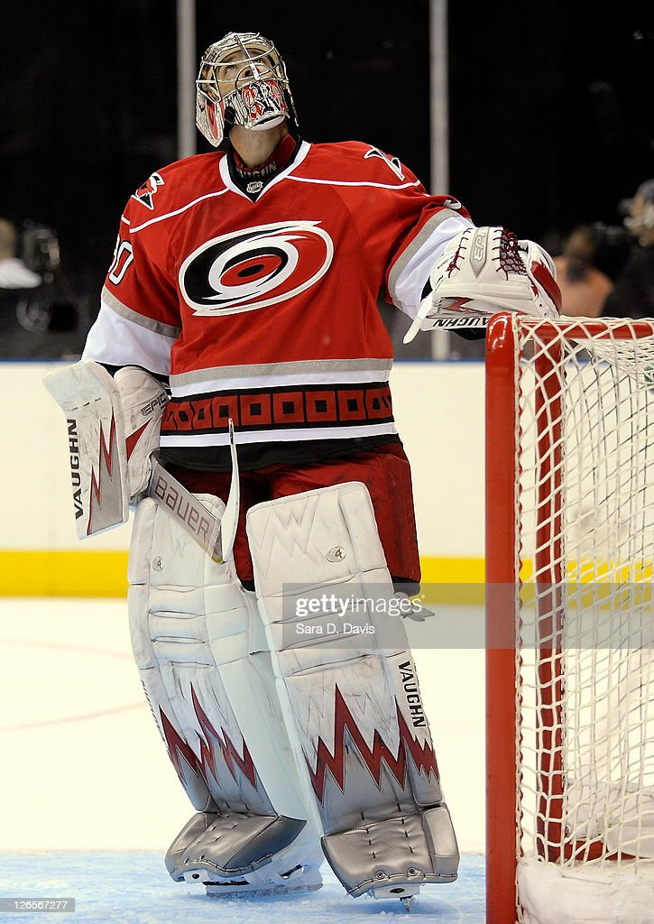 Goalie <a gi-track='captionPersonalityLinkClicked' href=/galleries/search?phrase=Cam+Ward&family=editorial&specificpeople=453216 ng-click='$event.stopPropagation()'>Cam Ward</a> #30 of Carolina Hurricanes watches rain water leak from the ceiling onto the ice during an NHL pre-season hockey game against Winnipeg Jets at the Time Warner Arena September 25, 2011 in Charlotte, North Carolina. Carolina won 4-0 over Winnipeg.