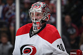Goalie Cam Ward of the Carolina Hurricanes defends the net against the Colorado Avalanche at Pepsi Center on October 21 2015 in Denver Colorado The...