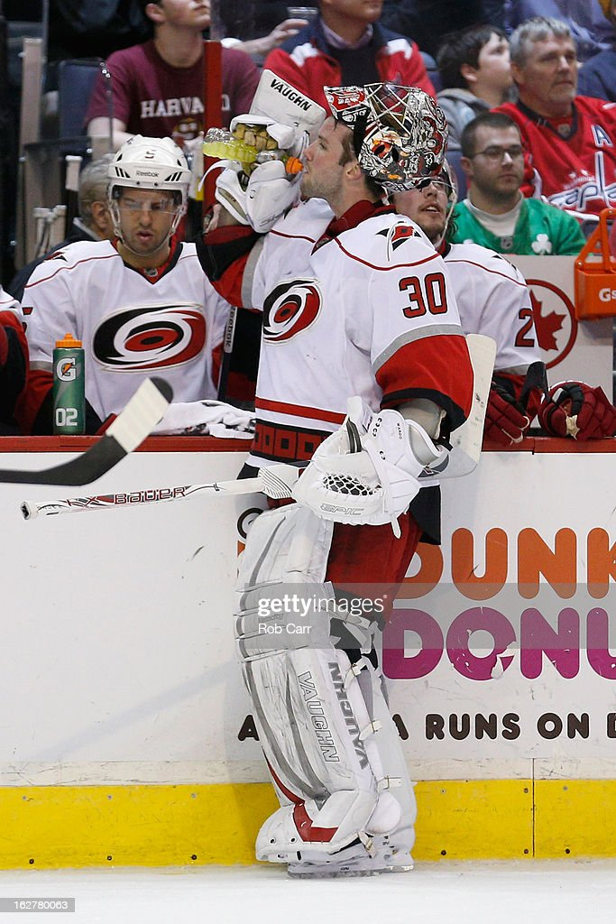 Goalie Cam Ward #30 of the Carolina Hurricanes gets a drink during the third period of the Hurricanes 3-0 loss to the Washington Capitals at Verizon Center on February 26, 2013 in Washington, DC.