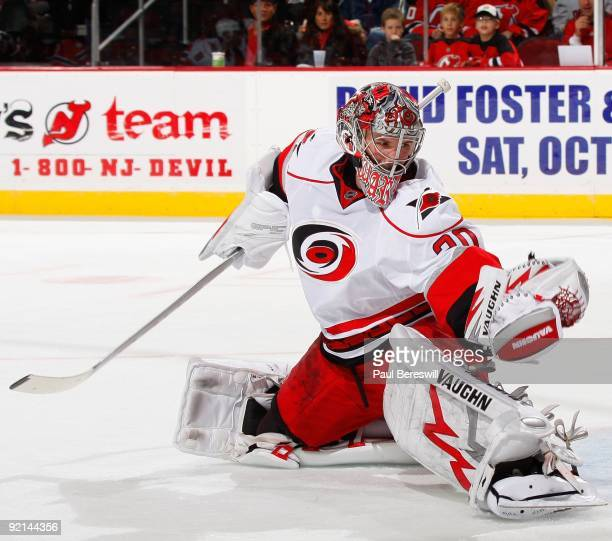Goalie Cam Ward of the Carolina Hurricanes makes a save during a hockey game against the New Jersey Devils at the Prudential Center on October 17...