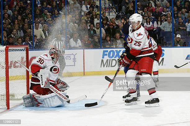 Goalie Cam Ward of the Carolina Hurricanes makes a save in an NHL game against the St Louis Blues on October 21 2011 at Scottrade Center in St Louis...
